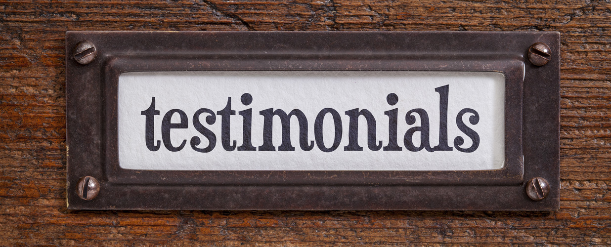 testimonials - a label on a grunge wooden file cabinet